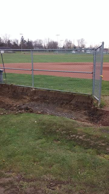 Grass and dirt removed for the new pad.