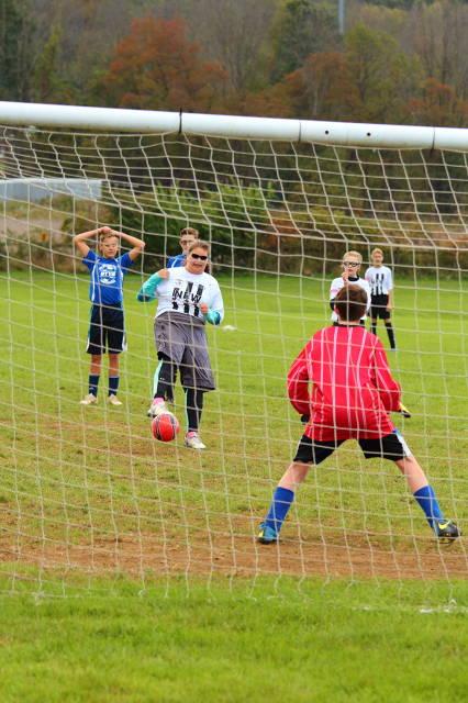 Olivia firing in a penalty kick