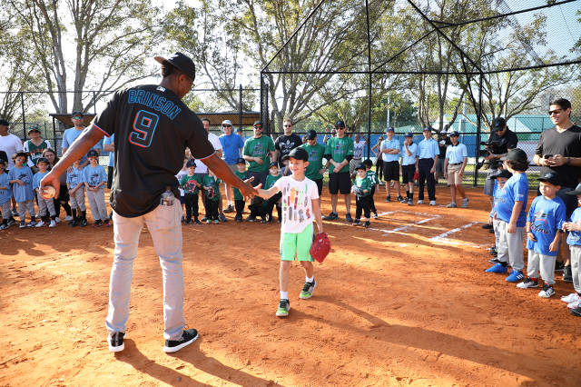 Lewis Brinson throws out the first pitch for T-Ball Opening Day.