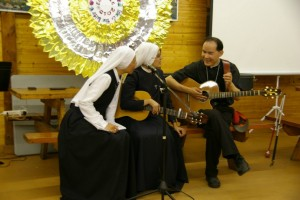 Photo by Colin Cheng, Fr. Francis participates in the music ministry as well on these missions.