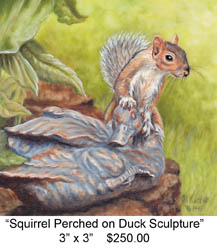 Squirrel Perched on Duck Sculpture c