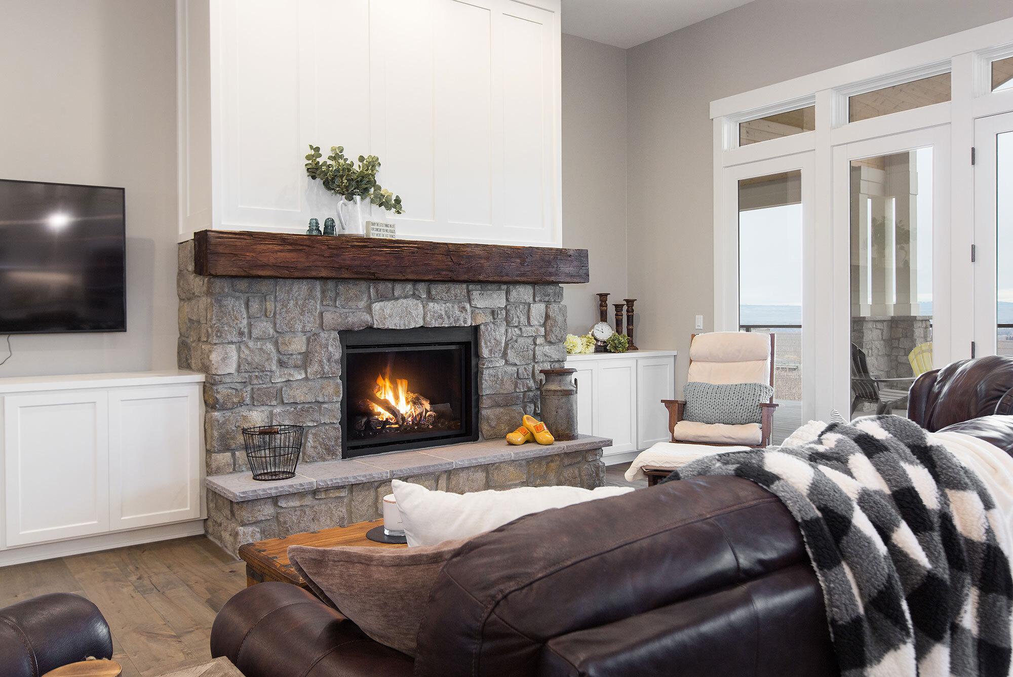 modern-ranch-living-room-stone-fireplace-custom-wood-mantle.jpg