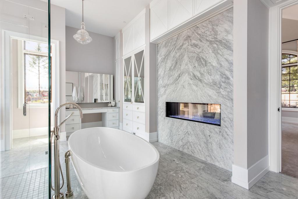 Master-bath- floating-tub-marble-raised-fireplace.jpg