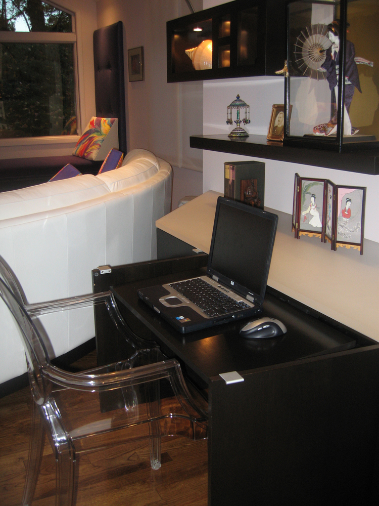 Home office hidden in family room cabinetry
