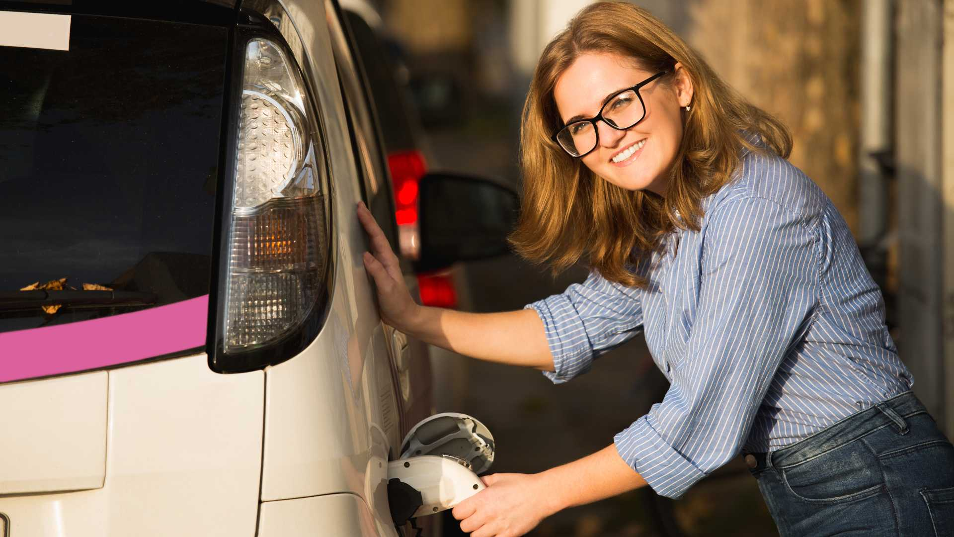 Woman is charging electric car