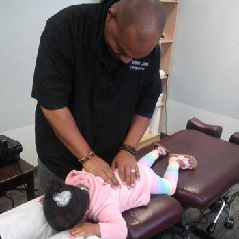 Dr._jones_adjusting_small_child
