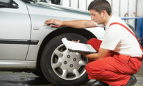 Wilson's Automotive Tire: Dent Removal