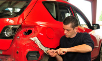 Dekalb Auto Center: Dent Removal