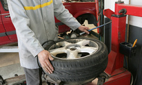 A & T Paint and Body Shop: Flat Tire Repair