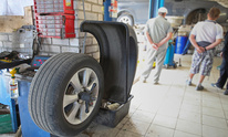 Bass Auto Sales: Flat Tire Repair