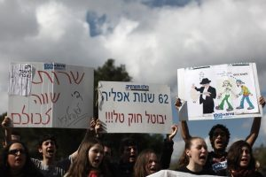 Young Israelis demonstrating outside the Prime Minister's Office in Jerusalem on Sunday, Jan 29, 2012 in protest of the plan to extend the Tal Law which exempts yeshiva students of IDF service.  Photo by Kobi Gideon / Flash90 *** Local Caption. Photo courtesy of http://www.jta.org