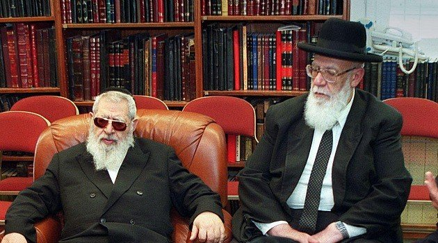 Shas leader Shalom Cohen, right, confers with late Rabbi Ovadia Yosef in 2000 photo. (courtesy of Forward.com)