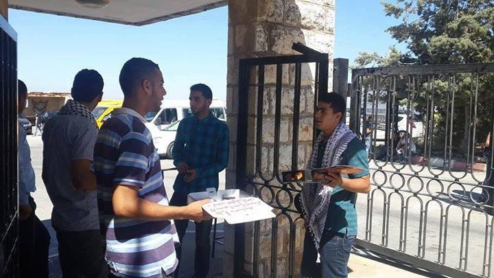University students in Birzeit University distribute sweets in celebration of the kidnapping of the three Israeli teenagers. Source: idfblog.com