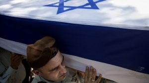 Israeli soldiers carry the coffin of Maj. Tzafrir Bar-Or, 32, one of 13 soldiers who were killed in several separate incidents in Shejaiya on Sunday, at the military cemetery in Holon, Monday, July 21, 2014. . (Photo credit: AP/Dan Balilty)