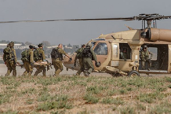 An injured Israeli soldier is evacuated by helicopter from near the Israeli border with Gaza Strip on July 21, 2014, following heavy fights between Israeli soldiers to Palestinian militants.  The Israeli army Spokesperson's Unit said two terror cells infiltrated into Israeli territory Monday morning through a tunnel in the northern Gaza Strip. Observation units identified the terrorists; Israeli Air Force planes attacked and hit the first cell.  Israeli army forces deployed to the area killed some 10 terrorists from the second cell. Photo by FLASH90