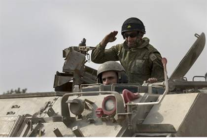 IDF soldiers in an armored personnel carrier near the Gaza border (7 July 2013) Reuters