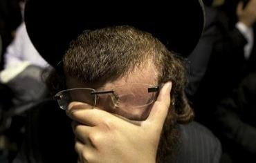 An Orthodox man weeps Photo: REUTERS/Lucas Jackson