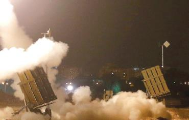 An Iron Dome launcher fires an interceptor rocket in the southern port city of Ashdod, July 8 Photo: REUTERS/BAZ RATNER