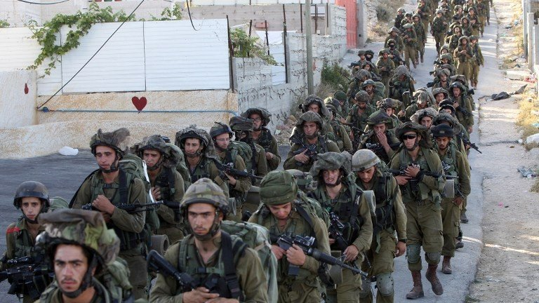 IDF soldiers in Hebron on June 17, 2014. (photo credit: AFP Photo/Hazem Bader)