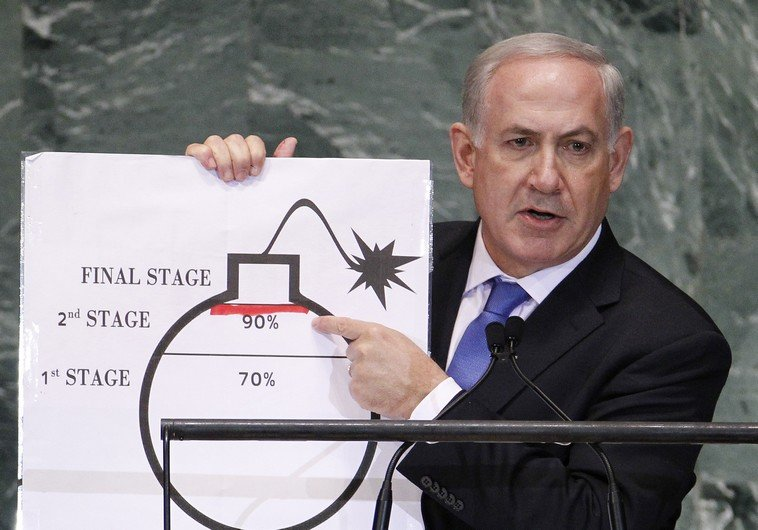 Israel's Prime Minister Netanyahu points to red line he has drawn on graphic of bomb as he addresses 67th United Nations General Assembly in New York