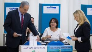 Prime Minister and head of the Likud party Benjamin Netanyahu casts his vote, together with his wife Sara Netanyahu, in the Likud primary elections on December 31, 2014. (Photo credit: Miriam Alster/Flash90)