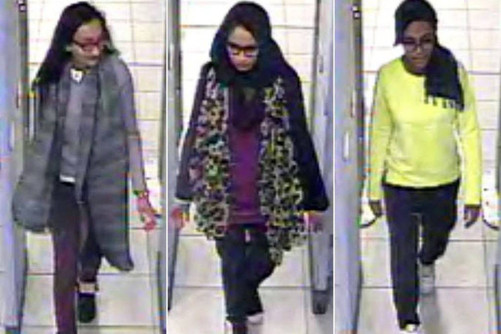Kadiza Sultana (from left), Shamima Begum and Amira Abase go through security at Gatwick airport.Photo: AP (3)