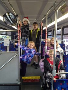 On the bus - Christmas caroling