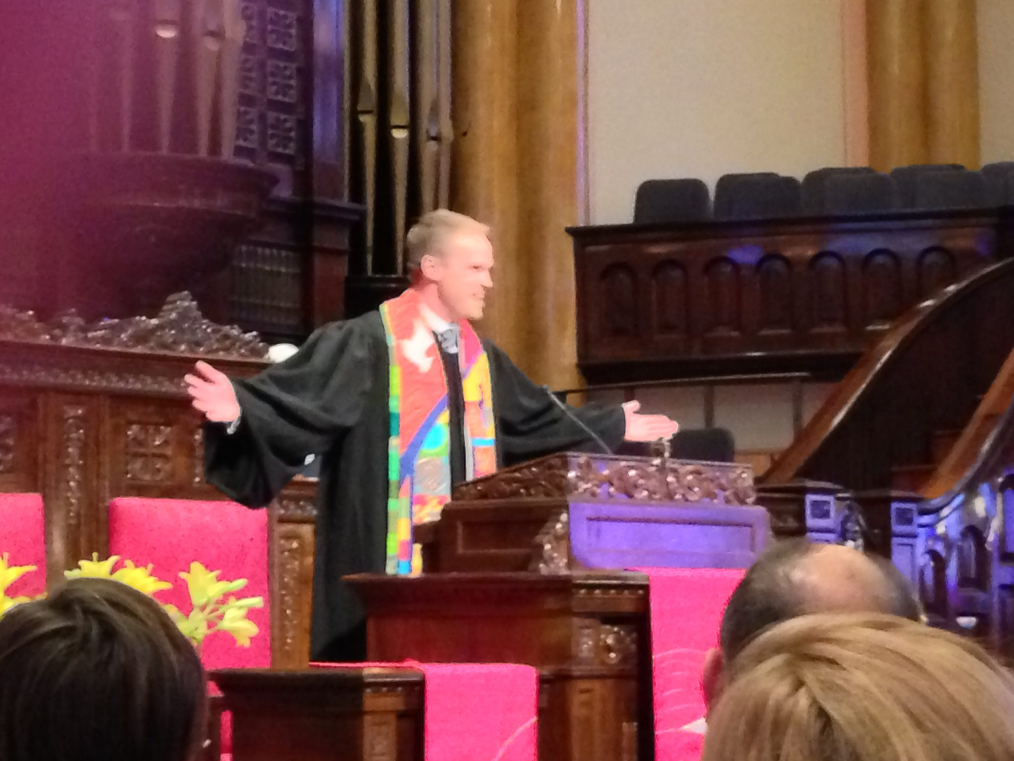 Dan delivers the benediction wearing his new robe and the three stoles given him during the service.