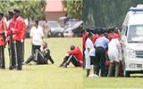Five policemen slump on parade ground