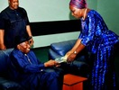 Kowa presidential candidate addresses issue raised over her posture while giving a book to GEJ
