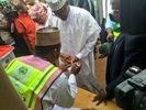 Photos of Gen. Buhari and wife doing their accreditation in Katsina