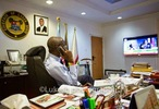 Pic of Gov. Fashola glued to his TV set watching announcement of INEC results