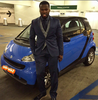 Lol. 50 cent poses by small car, says times are hard