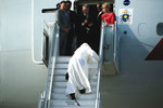 Pope Francis stumbles while boarding plane