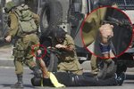 The moment Palestinian disguised as a reporter stabbed an Israeli soldier before being shot dead (photos)