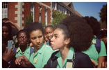 Black schoolgirls in South Africa protest after being told to straighten their hair