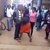 Woman beats up her husband in the middle of a street, accuses him of infecting her with STD (Photos & Video)