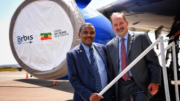 Orbis CEO and Ethiopia Minister of Health stand outside the Flying Eye Hospital