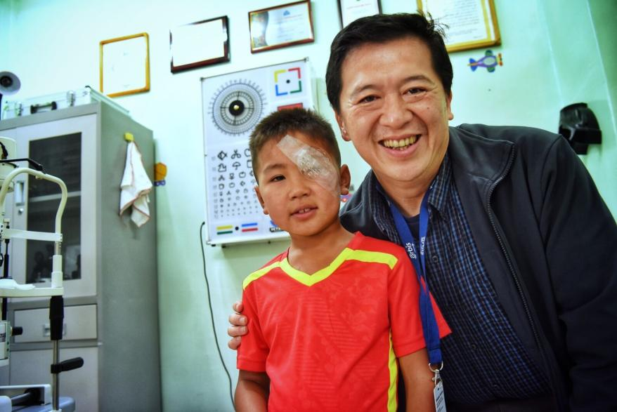 Nyamdorj with Orbis eye doctor after his first surgery