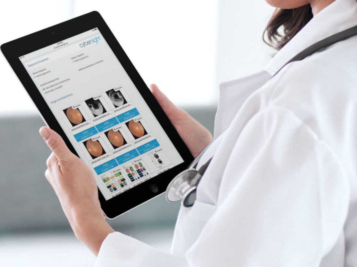 Consultation Screen Shot With Doctor Holding Tablet 003