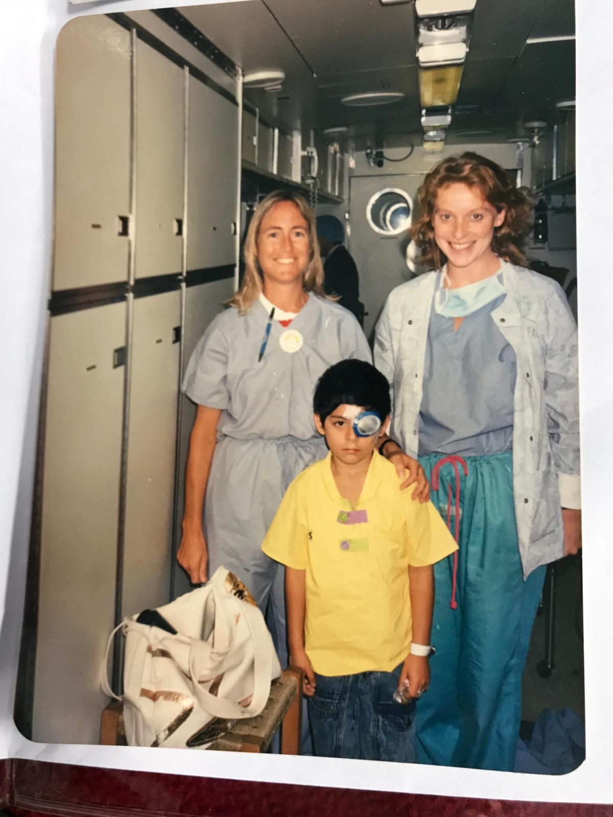 Orbis nurses with young patient.