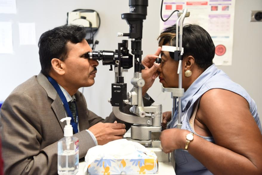 Doctor performs eye test.