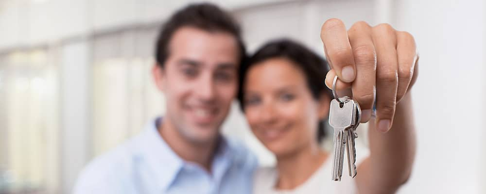 couple holding out house keys