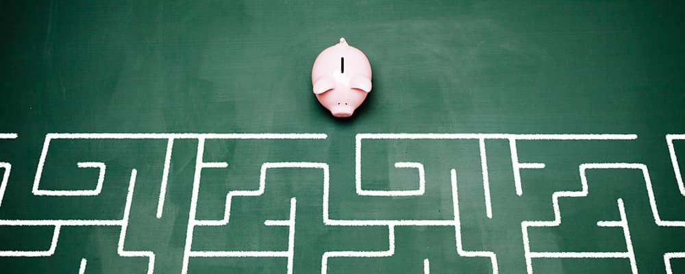 piggy bank faced with a maze