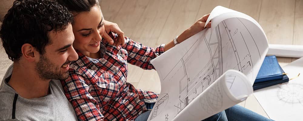 couple looking a house blueprint