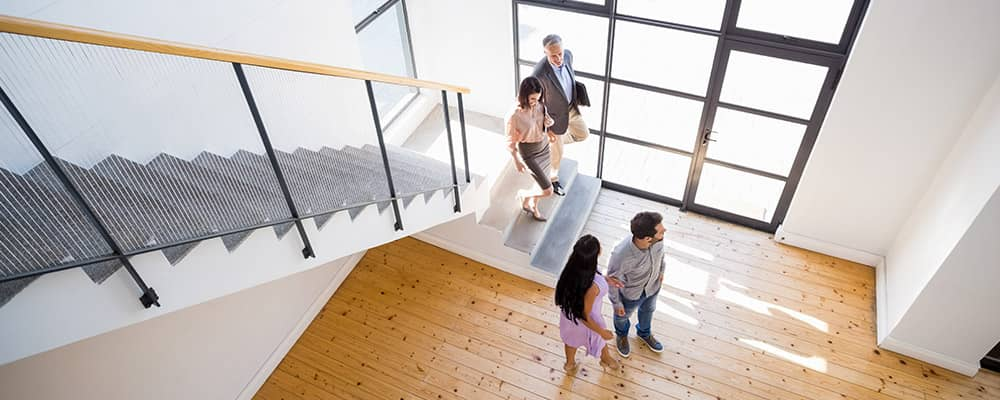 couple at an open house with a real estate agent