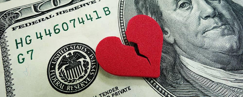broken heart on top of money