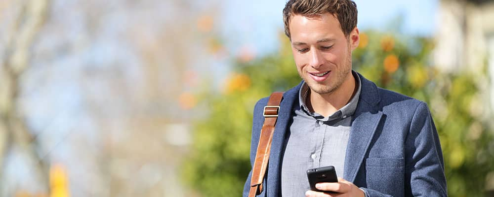 real estate agent checking his mobile phone