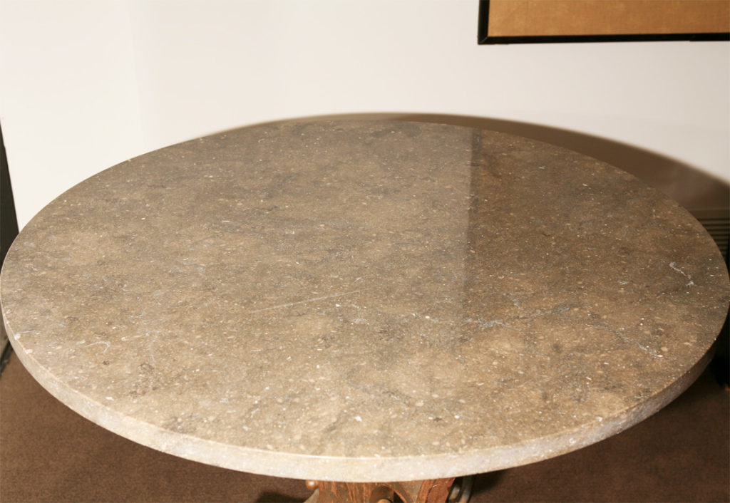 A French Wrought-Iron and Marble Top Round Bistro Table