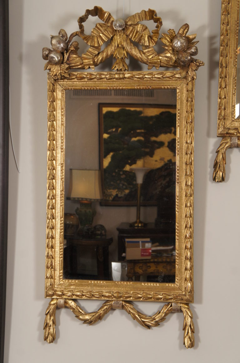 Pair of 19th Century Italian carved giltwood mirrors.